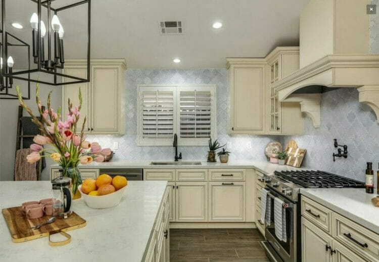 Signature Pearl Traditional Gally Kitchen | Springhill Kitchen & Bath | Custom, Budget, & Commercial Cabinetry | Gainesville, FL | Featuring Forevermark Cabinetry
